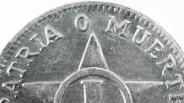 the 'patria o muerte' slogan in a one-cent coin on march 1 in cuba. the phrase has been the center of discussion after a group of exiled musicians... - plain background stock videos & royalty-free footage