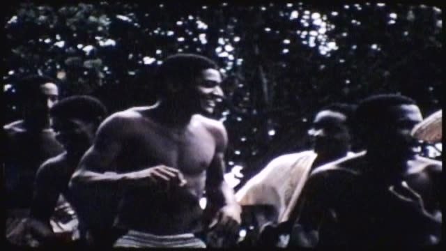 cuba men drumming and dancing on the beach - strohhut stock-videos und b-roll-filmmaterial