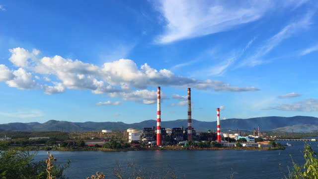 three chimneys of the thermoelectric antonio maceo better known as rente the energy provider is placed in an island at the center of the santiago de... - santiago de cuba stock videos and b-roll footage