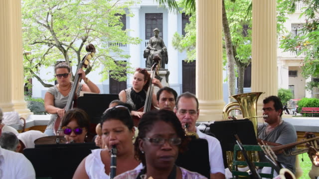 stockvideo's en b-roll-footage met concert day in the gazebo of the leoncio vidal plaza the tradition has the provincial band of music animate the national monument area which is also... - gazebo