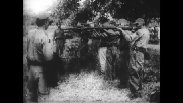 firing squad executing a person at the beginning of the cuban revolution. historic footage of the first years of the cuban revolution. historical... - audio available video stock e b–roll