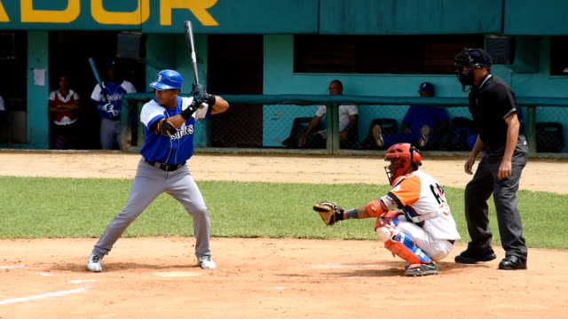 stockvideo's en b-roll-footage met industriales faces villa clara in the stadium sandino the game is a classic of the cuban baseball due to the traditional rivalry between the two teams - honkbalspeler