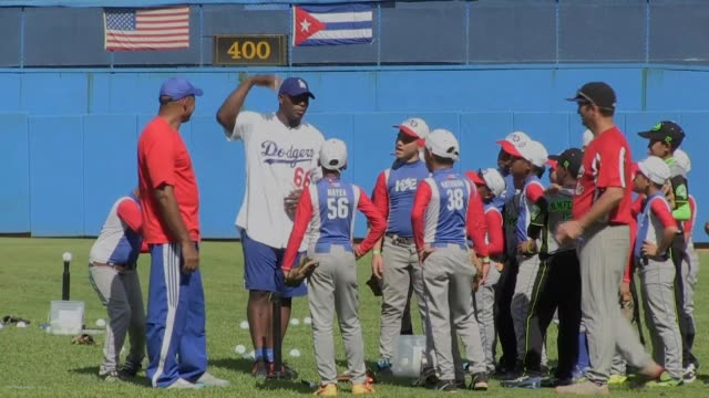 Cuban baseball stars Yasiel Puig and Jose Abreu returned home Tuesday for the first time since defecting to play in America as part of an...
