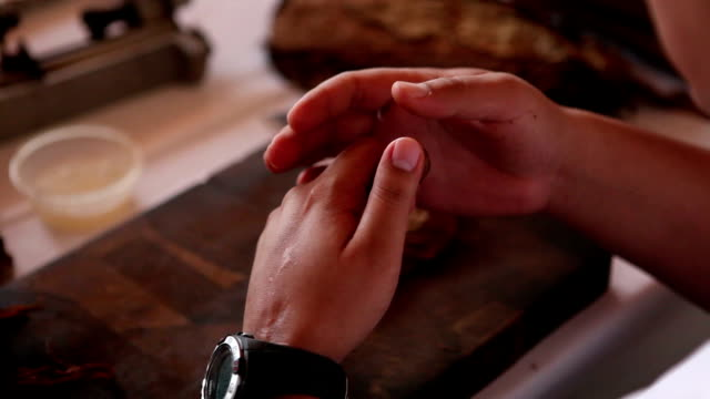cuban cigar rolling and cutting - cigar stock videos and b-roll footage