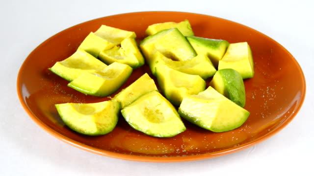 cuban cuisine: avocado pieces served for salad - avocado salad stock videos & royalty-free footage
