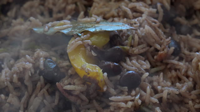 Cuban Cuisine: Close-up steaming Congri Rice. The Plate is Part of the Creole Cuban Culture