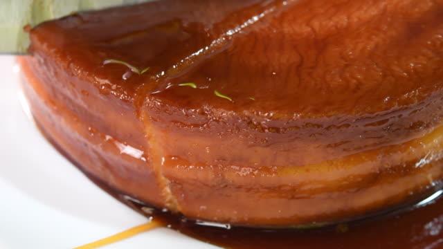 Cuban Cuisine: Cutting a Homemade Flan or Creme Caramel with Knife-Cuba