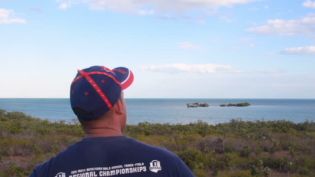 cuban fisherman looks the horizon in 'cayo blanco' from a light-tower in the inhabited place on march 20 in sancti spiritus province, cuba. the image... - horizon over water stock videos & royalty-free footage