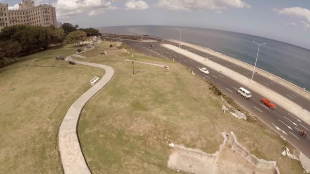 cuban flag to reveal hotel nacional in havana - hotel nacional stock videos and b-roll footage