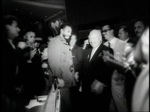 Cuban leader Fidel Castro and Soviet Premier Nikita Khrushchev meet in the lobby of the United Nations in New York City New York