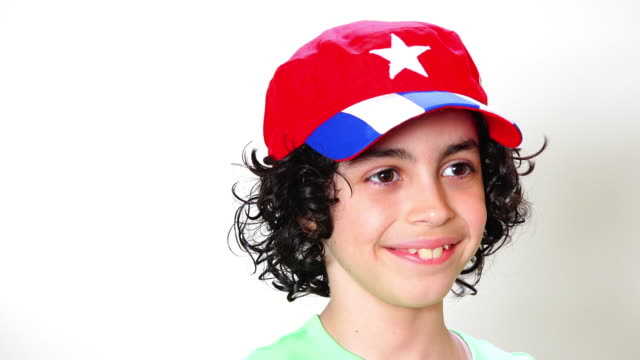 cuban male child with a baseball hat, studio shot - cap stock videos & royalty-free footage