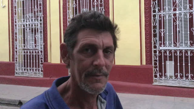 cuban man sings a 'pregon' in the city street on november 16, 2016; in camaguey, cuba. a 'pregon' is a short song for advertising some product while... - focus on background stock videos & royalty-free footage