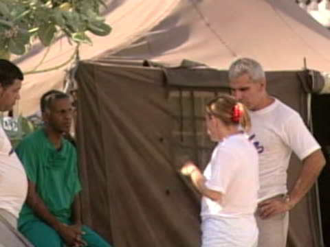 cuban medical staff stand outside makeshift camps following devastating earthquake in haiti 25 february 2010 - hispaniola stock videos & royalty-free footage