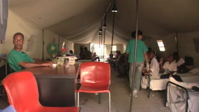 cuban medical staff tend to injured haitians at makeshift hospital following devastating earthquake in haiti 25 february 2010 - hispaniola stock videos & royalty-free footage