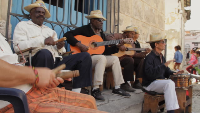 ws cuban musician playing clave / havana, cuba - cuba video stock e b–roll