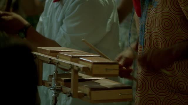 Cuban musicians play at a festival.