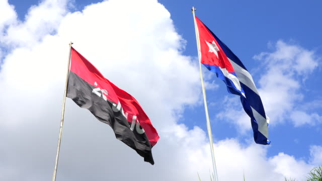 cuban national flag and the 26th of july movement flag waving flying together in daytime - communist flag stock videos & royalty-free footage