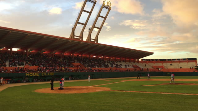 cuban national series of baseball in the sandino stadium at sunset baseball is the national sport in the caribbean island locals complains the sport... - 対戦試合点の映像素材/bロール