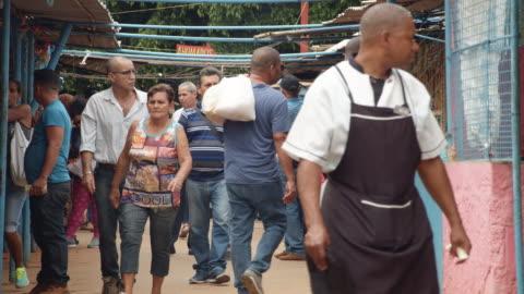 cuban people at a havana street market. slow motion - b roll stock videos & royalty-free footage
