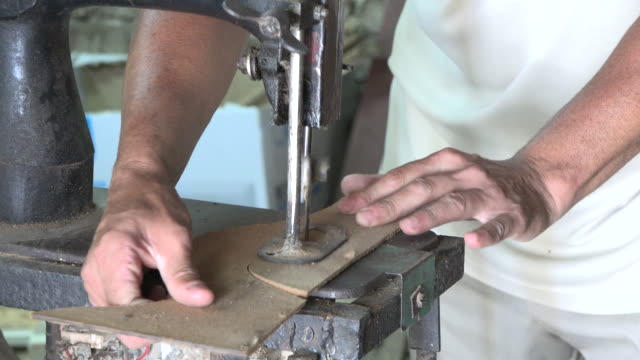 Cuban people lifestyles and work settings: working in carpentry shop