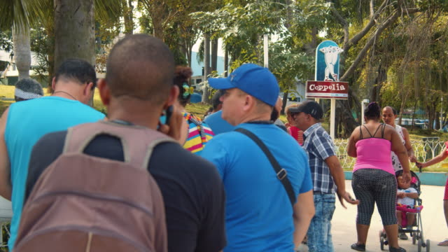 cuban people waiting at the coppelia ice cream shop entrance. vedado, havana - banner sign stock videos & royalty-free footage