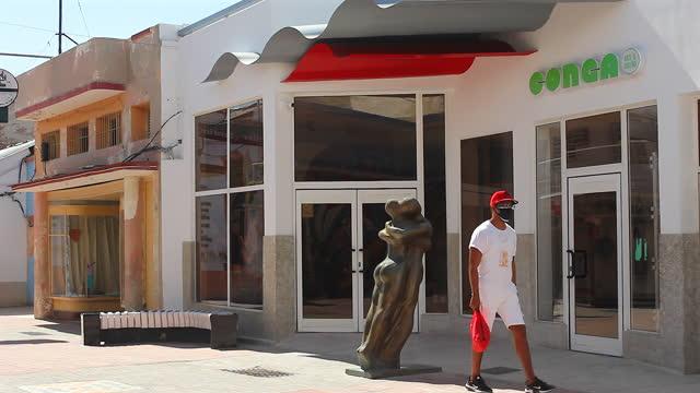 cuban people walk by the sculpture named 'pareja' by alberto lescay in the las enramadas promenade on may 30, 2021 in santiago de cuba, cuba. alberto... - boulevard stock videos & royalty-free footage