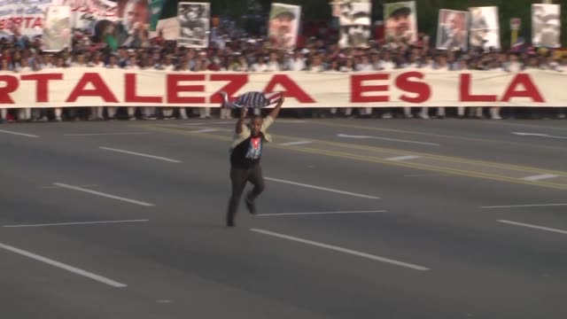cuban protester was arrested while waving an american flag during the may day celebration monday in havana as millions of cubans rallied for the... - brother stock videos & royalty-free footage