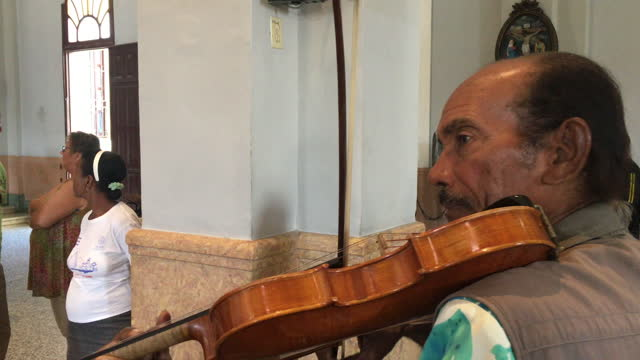 cuban senior man pays a 'promise' to our lady of charity of el cobre on june 20 in santiago de cuba, cuba. the cuban version of the virgin mary is... - mixed race person stock videos & royalty-free footage