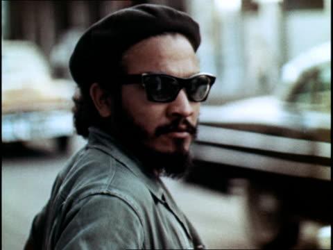 cuban street life emphasizing the diversity of havana - religiöse kleidung stock-videos und b-roll-filmmaterial