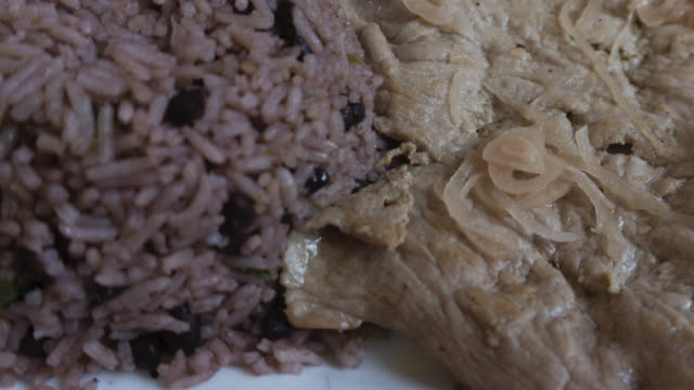 Cuban traditional creole cuisine: beef steak with congri rice and salad