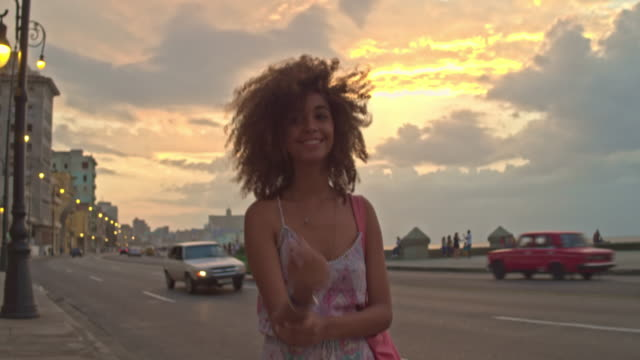 cuban woman walking at the malecon - curly hair stock videos & royalty-free footage