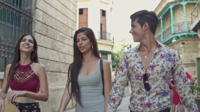 cuban young people walking in havana - havana stock videos & royalty-free footage