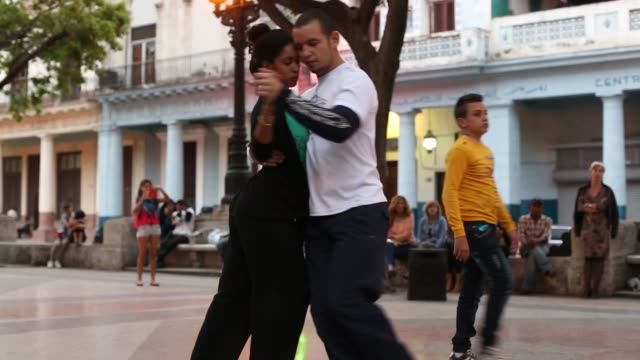 cubans dance the tango in the middle of the famous prado boulevard in habana vieja january 25 2015 in havana cuba - tangoing stock videos & royalty-free footage