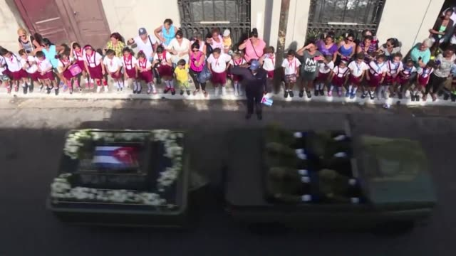 cubans line the streets of matanzas to see a military jeep carrying the ashes of fidel castro pass by - decorative urn stock videos and b-roll footage