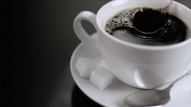 cube of sugar falling in super slow motion - sugar cube stock videos & royalty-free footage