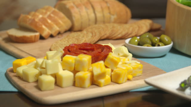 cubed cheese rack focus crackers - cracker stock videos and b-roll footage