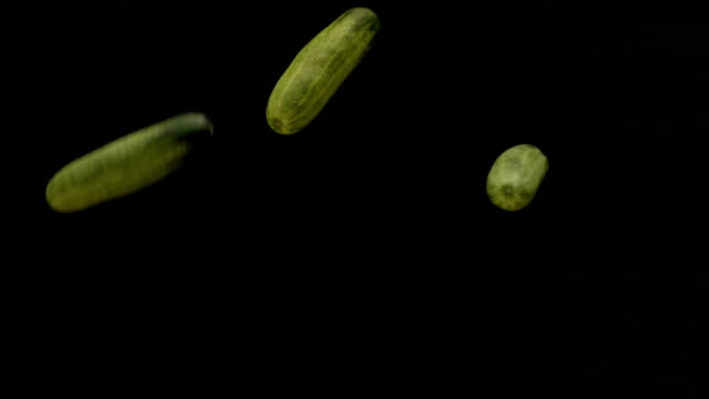 cucumber flying and falling slow motion. - cucumber stock videos & royalty-free footage