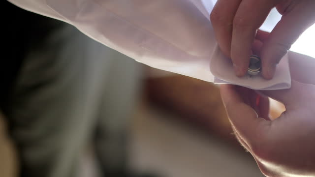 Cuff links - Stock Footage (wedding preparations)