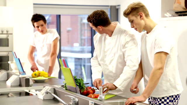 culinary school intructor teaching students in commercial kitchen - showing stock videos & royalty-free footage