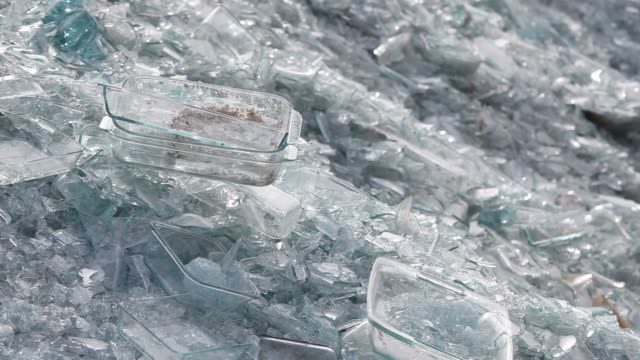 cullet, or broken glass recycled and used to make new pieces, is stored outdoors at the pyrex factory in charleroi, pa, tuesday february 2, 2016... - drinking glass stock videos & royalty-free footage