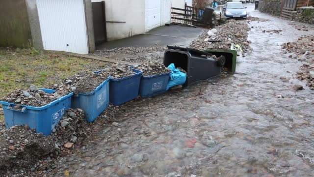 a culvert overflowing on blue hill, ambleside in the lake district on saturday 5th december 2015, during torrential rain from storm desmond. - rubble stock videos & royalty-free footage
