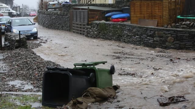 a culvert overflowing on blue hill ambleside in the lake district on saturday 5th december 2015 during torrential rain from storm desmond - overflowing stock videos & royalty-free footage