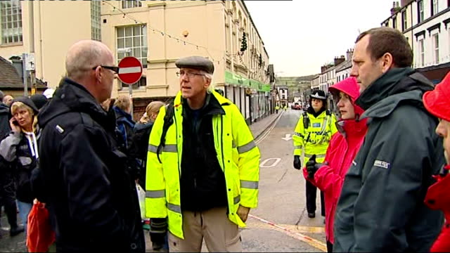 cumbria cockermouth ext shopkeepers gathering on high street and chatting sot business owners standing behind cordon phil radcliffe speaking to... - radcliffe camera stock videos and b-roll footage