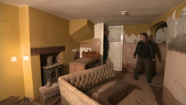 more weather warnings issued by met office charlotte ashley showing reporter around her flooddamaged home and interview sot - cumbria stock-videos und b-roll-filmmaterial