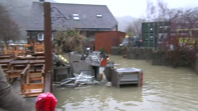 some areas flooded for third time in less than three weeks selina ali interview sot flood water being pumped away pan flooded glenridding hotel... - カンブリア州点の映像素材/bロール