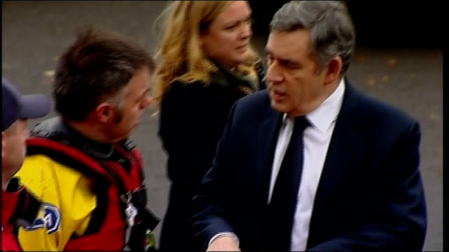 gordon brown visit to rescue centre in cockermouth england cumbria cockermouth ext car arriving gordon brown mp along from car and shaking hands with... - gordon brown stock videos & royalty-free footage