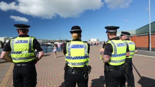 cumbria police officers guard the launching of the latest navy astute class nuclear powered submarine, from bae systems in barrow in furness,... - tattoo stock videos & royalty-free footage