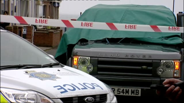 12 dead after gunman goes on rampage seascale ambulance along land rover car with windscreen covered by green sheet vox pop near boot various police... - land rover stock videos and b-roll footage