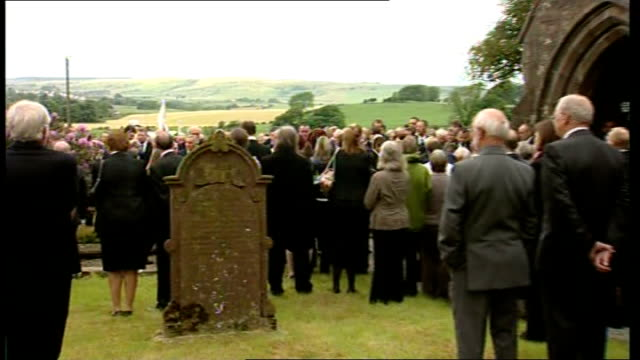 david bird funeral david bird coffin carried from hearse into church past mourners/ mourners stand outside church listening to service inside and... - hearse stock videos & royalty-free footage