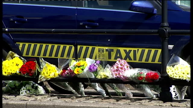 derrick bird was legal owner of guns england cumbria whitehaven ext floral tributes at taxi rank where taxi driver darren rewcastle was shot dead by... - derrick bird cumbria stock-videos und b-roll-filmmaterial